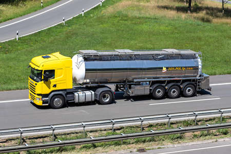 TON-POL Scania truck with tank trailer on motorway.