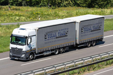 Stebal Trans Mercedes-Benz Actros combination truck on motorway. Archivio Fotografico - 156209897