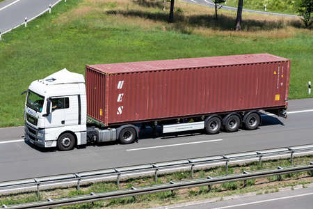 Neva Trans MAN truck with UES container on motorway. Editoriali