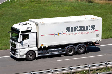 Juan Transport MAN TGX truck with Siemes swop body on motorway.