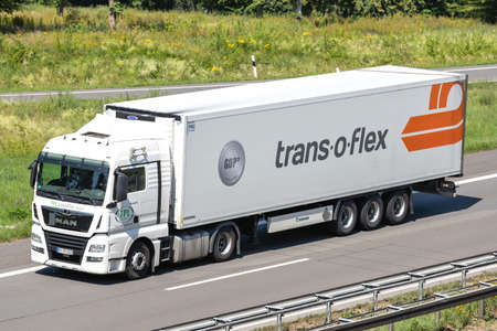 TPL Logistik MAN TGX truck with temperature controlled trans-o-flex trailer on motorway. Editoriali