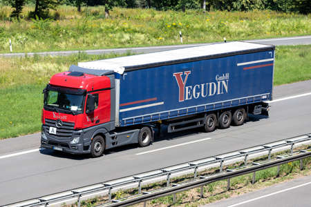 Yegodin Mercedes-Benz Actros truck with curtainside trailer on motorway. Editoriali