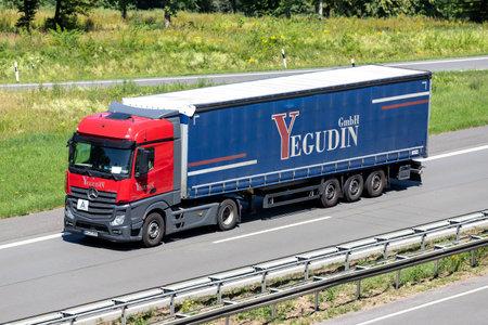 Yegodin Mercedes-Benz Actros truck with curtainside trailer on motorway. Archivio Fotografico - 156209890