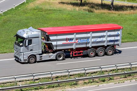 Udo Schmidt Mercedes-Benz Actros truck with tipper trailer on motorway.