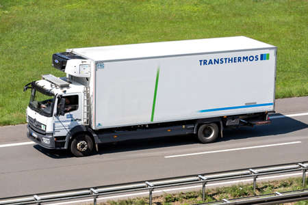 Transthermos Mercedes-Benz Atego truck on motorway.