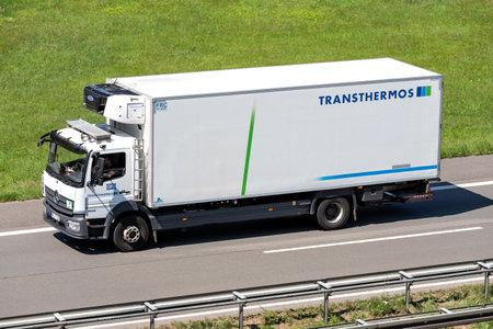 Transthermos Mercedes-Benz Atego truck on motorway. Archivio Fotografico - 156209891