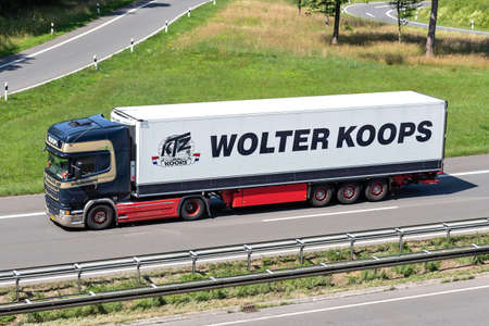 Wolter Koops Scania truck on motorway. Wolter Koops is a Dutch service provider in temperature-controlled transport and logistics.