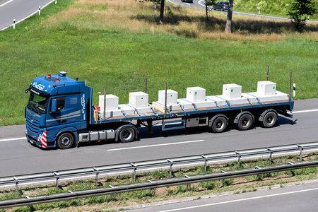 Wocken Mercedes-Benz Actros truck with flatbed trailer on motorway. Archivio Fotografico - 156208163