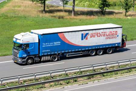 Versteijnen Scania R410 truck with curtainside trailer on motorway.