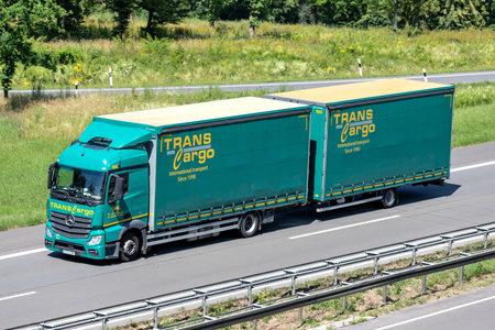 Trans Cargo Mercedes-Benz Actros combination truck on motorway. Archivio Fotografico - 156209894