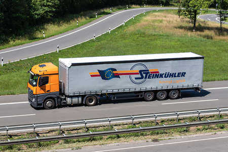 Steinkühler Mercedes-Benz Actros truck with curtainside trailer on motorway.