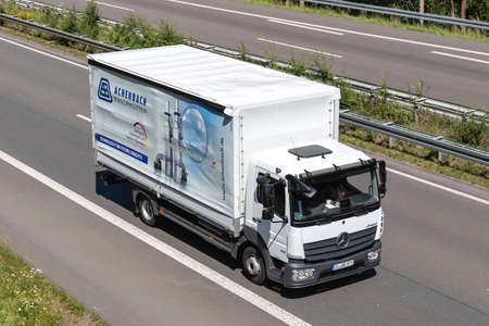 Achenbach Mercedes-Benz Atego truck on motorway.