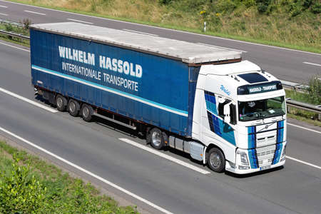 Wilhelm Hassold Volvo FH truck with curtainside trailer on motorway.