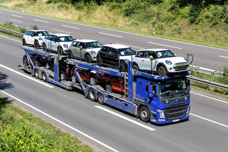 Beljana Volvo FM car-carrying truck on motorway.