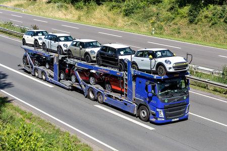Beljana Volvo FM car-carrying truck on motorway. Archivio Fotografico - 156764559