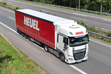 Heuel DAF XF truck with curtainside trailer on motorway.