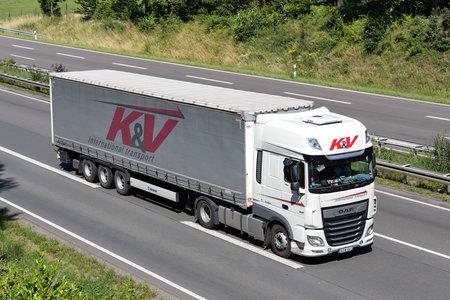 K&V DAF XF truck with curtainside trailer on motorway. Archivio Fotografico - 156764534