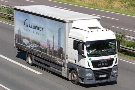 Aluprof MAN TGX truck on motorway. Archivio Fotografico - 156764387