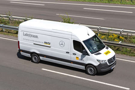 Hertz Mercedes-Benz Sprinter on motorway. The Hertz Corporation is an American car rental company based in Estero, Florida. Archivio Fotografico - 156764573