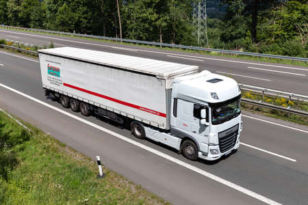 European Transport DAF XF truck with curtainside trailer on motorway. Archivio Fotografico - 156764566
