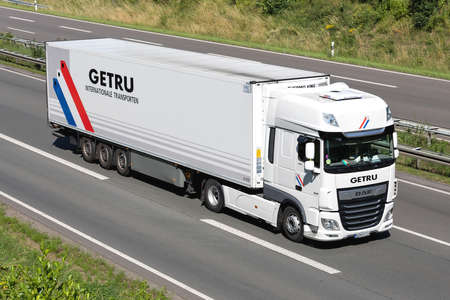 GETRU DAF XF truck with temperature controlled trailer on motorway.