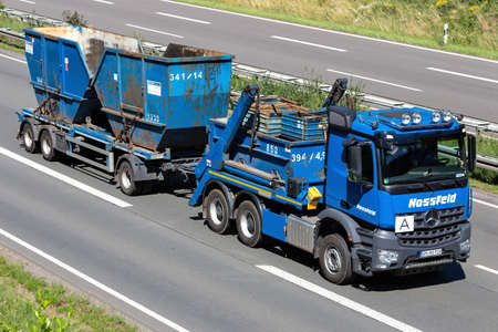Hossfeld Mercedes-Benz Arocs truck on motorway. Editoriali