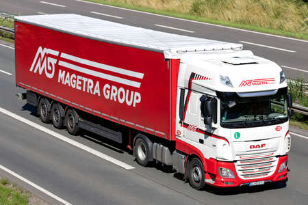 Magetra DAF XF truck with curtainside trailer on motorway. Archivio Fotografico - 156764499