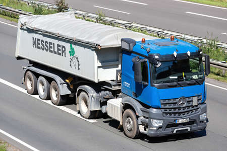 Nesseler Mercedes-Benz Actros truck with tipper trailer on motorway. Editoriali