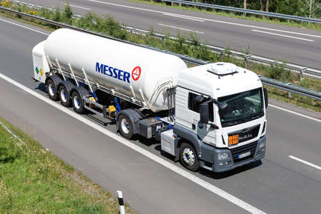 Schmidt MAN TGS truck with Messer gas trailer on motorway. Editoriali