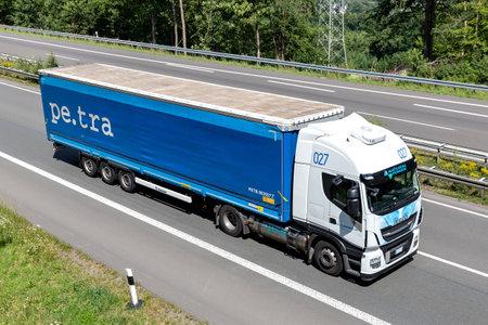 pe.tra Iveco Stralis truck with tarpaulin trailer on motorway. Archivio Fotografico - 156764510