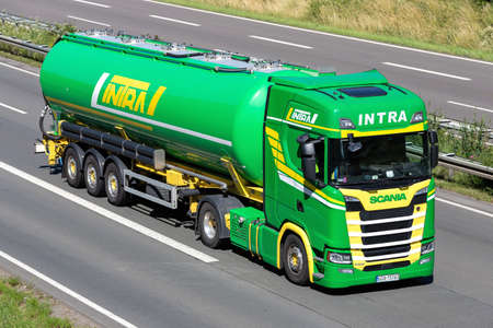 Intra Scania S500 truck with silo trailer on motorway. Editoriali