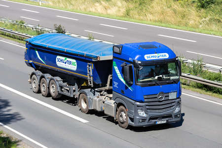 Schuster Mercedes-Benz Actros truck with tipper trailer on motorway. Editoriali