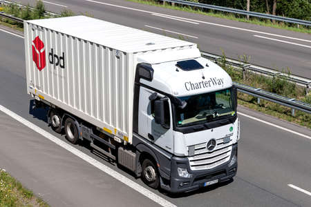 CharterWay Mercedes-Benz Actros truck with dpd swop body on motorway. Editoriali