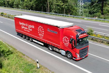 Gebrüder Rost Volvo FH truck with curtainside trailer on motorway. Archivio Fotografico - 156764515