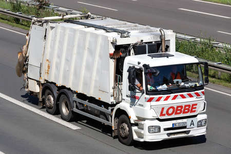 Lobbe dustcart on motorway. Lobbe provides consistent service in the areas of decontamination, industrial services and disposal. Archivio Fotografico - 156764536