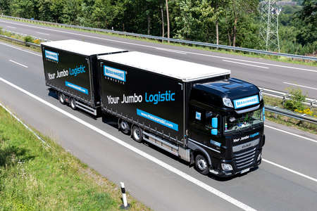 Maszonski DAF XF combination truck on motorway. Editoriali