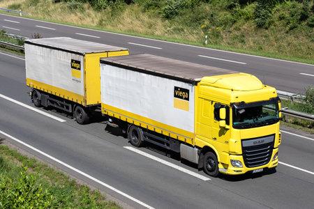 Viega DAF XF combination truck on motorway. Archivio Fotografico - 156764455