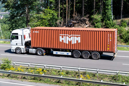 MAN TGX truck with HMM container on motorway. Archivio Fotografico - 156764539