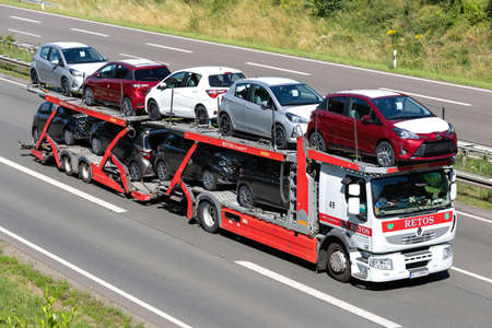 Retos Renault car-carrying truck on motorway. Editoriali