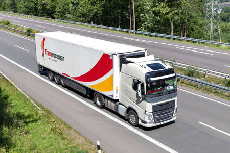 Volvo FH truck with Transrocamar temperature controlled trailer on motorway. Archivio Fotografico - 156764448