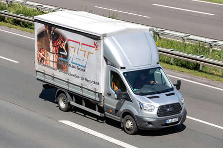 SLT Ford Transit van on motorway. Archivio Fotografico - 156764479