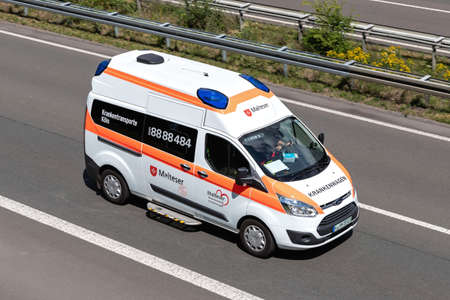 Malteser ambulance on motorway. The Malteser Hilfsdienst e. V. in Germany is a Catholic relief organization. Editoriali