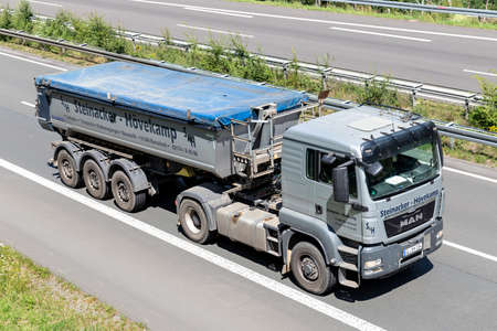 Steinacker-Hövekamp MAN TGS truck with tipper trailer on motorway. Archivio Fotografico - 156764481