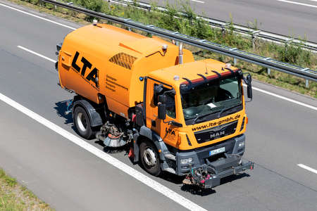 LTA MAN TGM road sweeper on motorway.