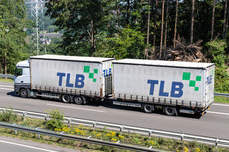 Mercedes-Benz Actros combination truck with TLB swop bodies on motorway.