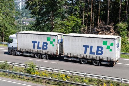 Mercedes-Benz Actros combination truck with TLB swop bodies on motorway. Archivio Fotografico - 156764485