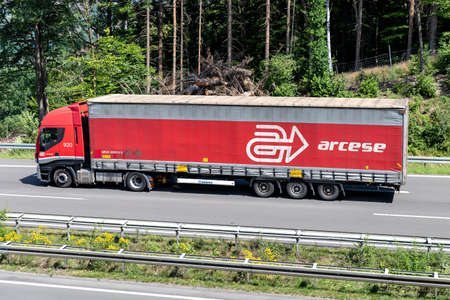 arcese Iveco Stralis truck with curtainside trailer on motorway.