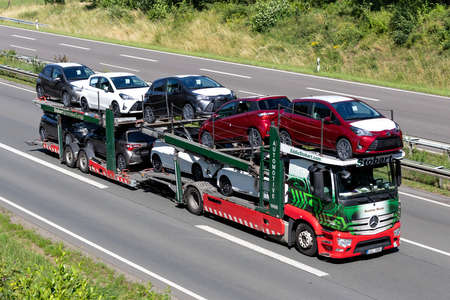 Eddie Stobart car-carrying truck on motorway.