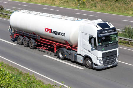 Volvo FH truck with XPO Logistics silo trailer on motorway. Editoriali