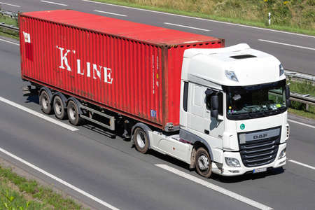 """DAF XF truck with """"K�Line container on motorway."""